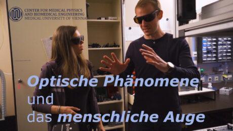 """Zwei Menschen mit Spezialbrillen. Text: """"Optische Phänomene und das menschliche Auge"""". Logo Center for Medical Physics and Biomedical Engineering, Medical University of Vienna"""