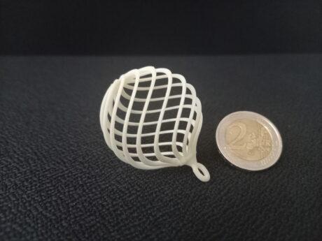 Eine Münze und ein 3D-Druckobjekt